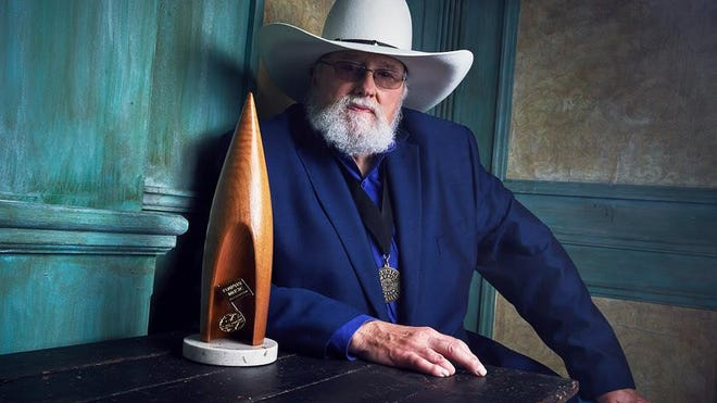"Charlie Daniels poses at ""The 50th Annual CMA Awards"" in 2016, the same year he was inducted into the Country Music Hall of Fame."