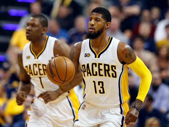 Indiana Pacers forward Paul George (13) brings the