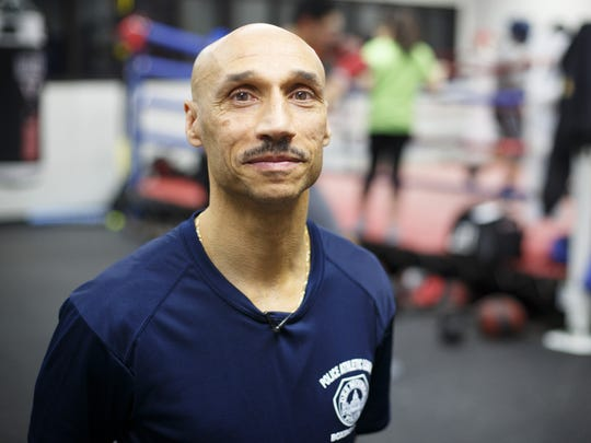 Des Moines Senior Police Officer John Saunders stands for a portrait at the Des Moines Police Boxing Club on Thursday, Jan. 26, 2017.