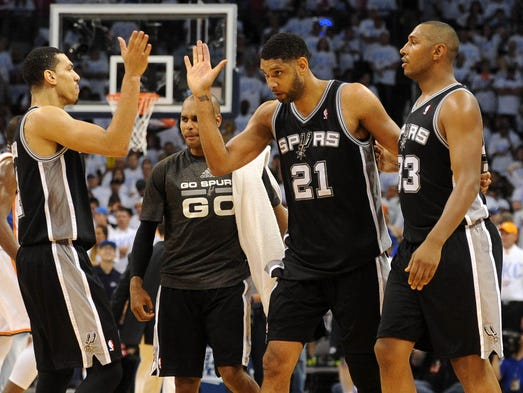 Game 6 in Oklahoma City: Spurs 112, Thunder 107 (OT) -- From left, Danny Green, Tim Duncan and Boris Diaw celebrate a late bucket in San Antonio's series-clinching victory.