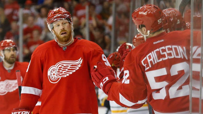Detroit Red Wings left wing Johan Franzen (93) celebrates his goal against the Buffalo Sabres in the third period during an NHL hockey game in Detroit Tuesday, Dec. 23, 2014.