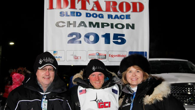 Jim Keller, his wife, Rosanne and Dallas Seavey at the 2015 Iditarod sled dog race finish line on March 18, 2015.