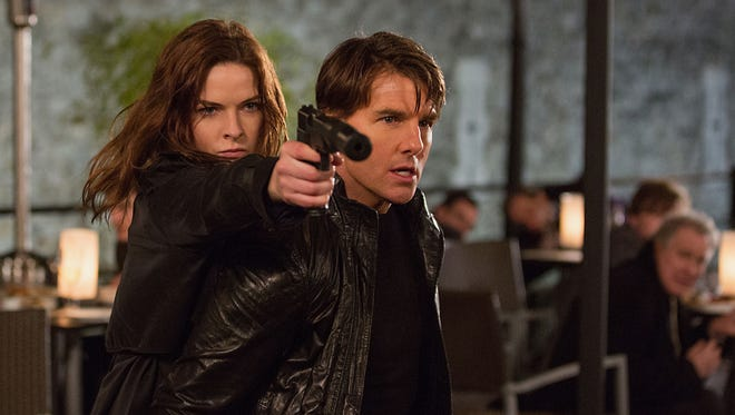 "Rebecca Ferguson and Tom Cruise appear in ""Mission: Impossible — Rogue Nation,"" in theaters on July 31."