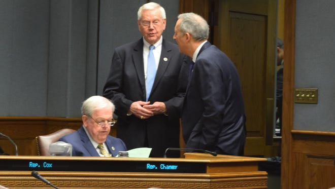 House Health and Welfare Committee Chairman Rep. Frank Hoffmann, R-West Monroe, center, talks with other members of the committee.