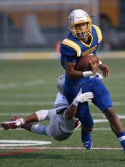 Irondequoit quarterback Freddy June Jr. is tackled