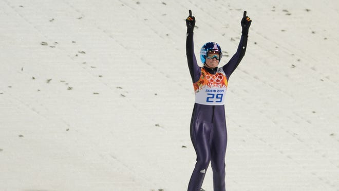 Carina Vogt of Germany is pleased with her jump.