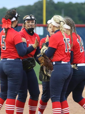 The Heritage team gathers for a meeting at the mound during one of its six meetings with an evenly-matched Greenbrier squad.