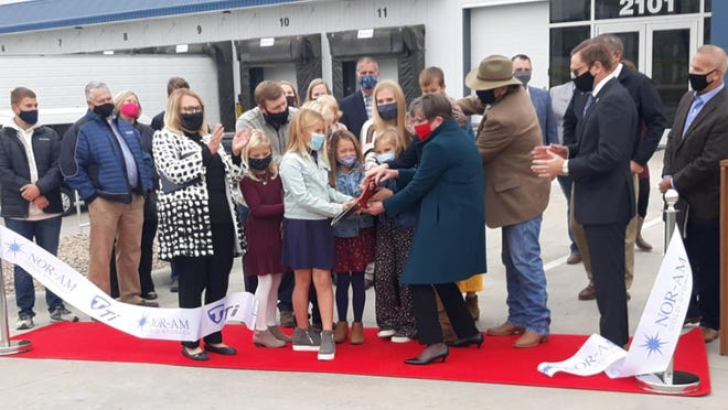 Gov. Laura Kelly cutting the ribbon at the grand-opening ceremony for the new Nor-Am Cold Storage facility located on 2101 E. Trail Street in Dodge City.