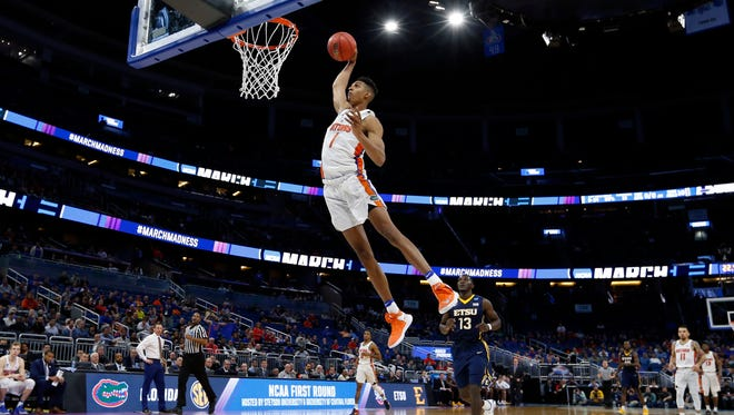 Florida Gators forward Devin Robinson flies in for a dunk against East Tennessee State.