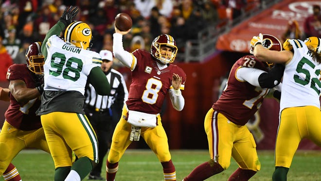Washington quarterback Kirk Cousins (8) attempts a pass against the Green Bay Packers during the second half at FedEx Field.