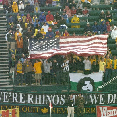 Fans wave a flag during the inaugural match at Rochester's