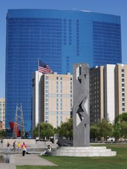 The JW Marriott hotel at Marriott Place provides a backdrop for the sculpture Totem by Rinado Paluzzi in White River State Park.