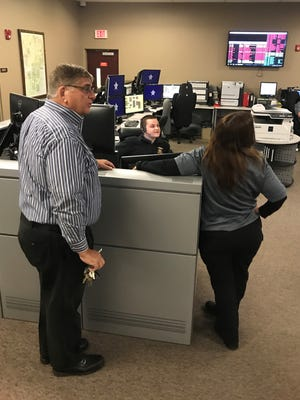Ocean County Sheriff Michael G. Mastronardy (left) visits the county's 911 call center in Toms River Friday to thank operators such as Cody Jordan (center, seated) for their service during National Public Safety Telecommunicators Week.