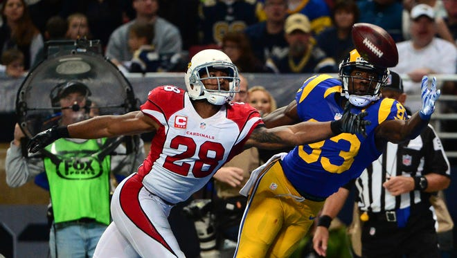 Dec 6, 2015: Arizona Cardinals cornerback Justin Bethel (28) defends against St. Louis Rams wide receiver Brian Quick (83) during the second half at the Edward Jones Dome. The Cardinals defeated the Rams 27-3.