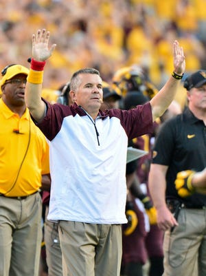 Arizona State coach Todd Graham signals during the second half against the Washington Huskies at Sun Devil Stadium.