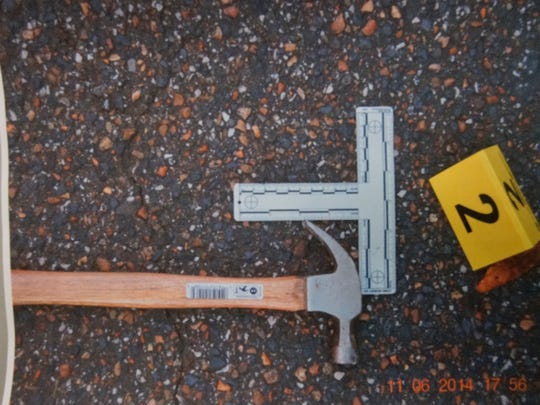 Jackson police provided a photo of the hammer that they said Cinque D'Jahspora threw at Officer Raymond Bond. Police said D'Jahspora also stabbed Bond with a knife before Bond fatally shot D'Jahspora. A grand jury decided Monday not to charge the officer in the November shooting.