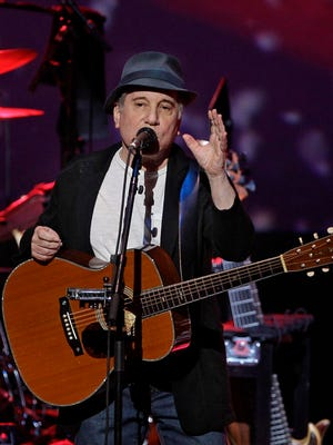 Paul Simon performs at Justin Vernon and Aaron Dessner's Eaux Claires festival on June 17.