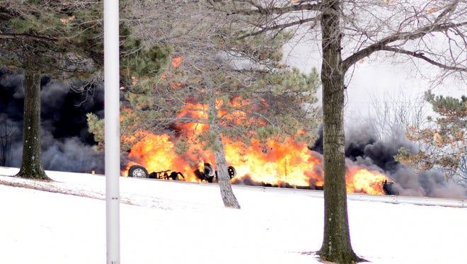 A tanker truck carrying 8,900 gallons of fuel overturned and ignited at the base of the Betsy Ross Bridge in Pennsauken closing Route 90. The fire was close to Wyndam and Greenbrier Roads which were also closed as firefighters worked to put out the fire. Monday, February 23, 2015.