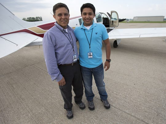Babar Suleman and his 17-year-old son, Haris, posed in June before embarking on their attempt to fly around the world. Haris died July 22 when their plane crashed off American Samoa; his father's body has not been found.