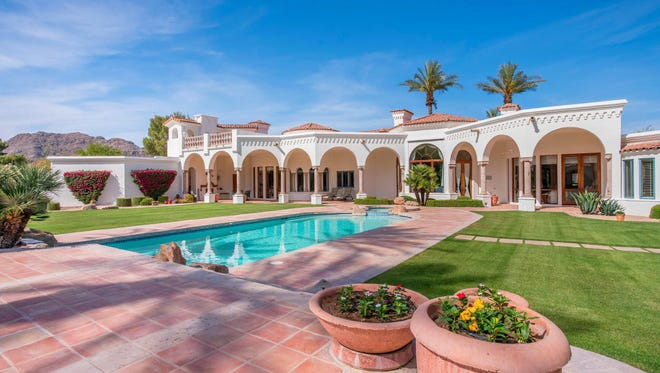 Carol Keogh, president and CEO of ESI Ergonomic Solutions, and her husband John, co-owner of ESI, paid cash for this 5,975-square-foot Tuscan-style mansion in Paradise Valley's Tilyou Ranchitos community.