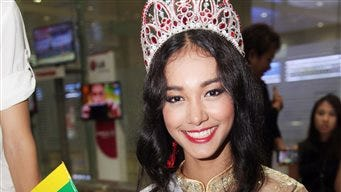 Myanmar model May Myat Noe, winner of Miss Asia Pacific World 2014 pageant, waves a miniature flag of the country upon her arrival at Yangon International Airport in Yangon, Myanmar. The first Myanmar national to win an international pageant has been stripped of her title for being rude and dishonest, and has allegedly run off with the expensive crown and breast implants.