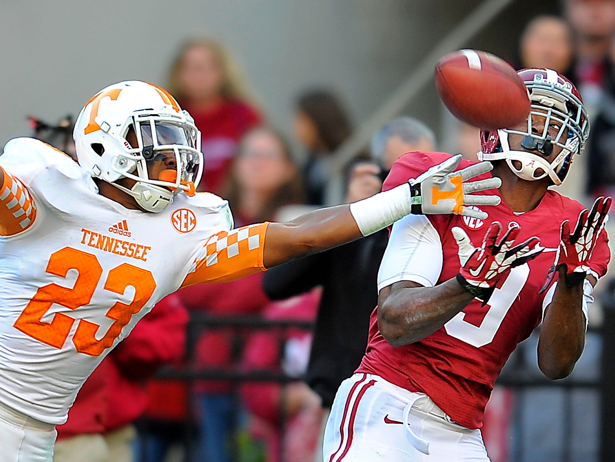 Tennessee defensive back Cameron Sutton (23) is a step behind Alabama wide receiver Amari Cooper (9) and can't keep him from catching a pass as the University of Tennessee plays Alabama at Bryant-Denny Stadium in Tuscaloosa on Saturday Oct. 26, 2013.