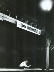 In this 1993 Democrat file photo, Thomasville resident John Hardwick reads the newspaper while waiting on the 2:05 a.m. train at Tallahassee's Amtrak depot on Railroad Avenue. Hardwick was in Tallahassee to pick up a passenger arriving on Amtrak's first official stop in Tallahassee.