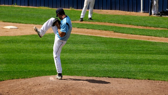 Watkins pitcher Matt Geislinger pitches the ball to his opponent on Sunday afternoon at the Watkins Clippers Baseball Park on July 17 in Watkins.