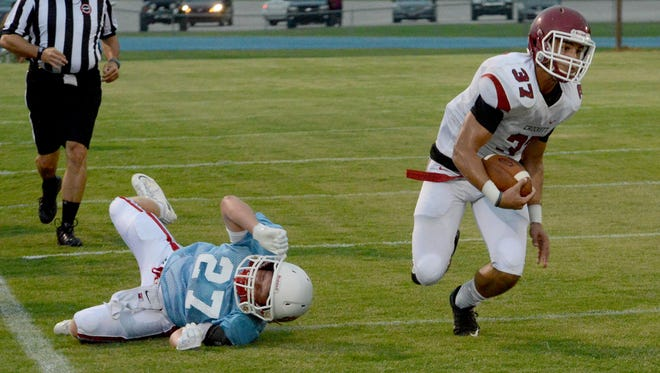 Crockett County's Xavier Billings avoids a tackle from University School of Jackson's Griffin Laird during their scrimmage.