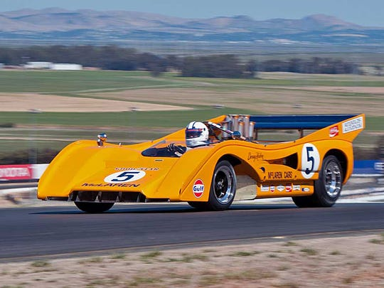 Chris MacAllister, owner of MacAllister Machinery and a vintage car collector/enthusiast. MacAllister in a McLaren