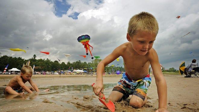 Kids enjoy Neshotah Beach in Two Rivers.