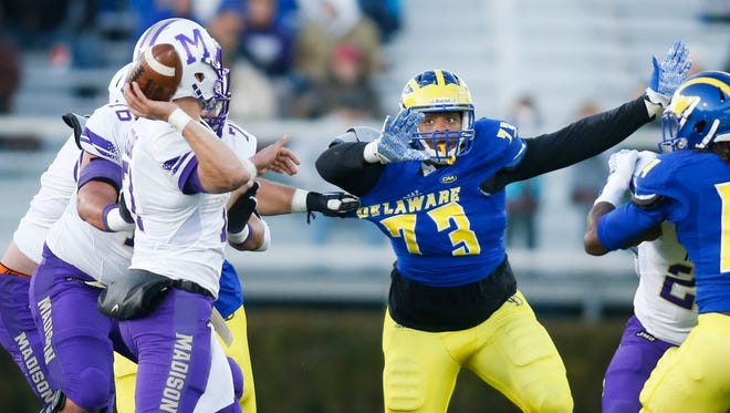 Delaware defensive lineman Blaine Woodson moves against James Madison quarterback Bryn Schor in the second quarter of Delaware's 24-21 loss at Delaware Stadium Saturday.