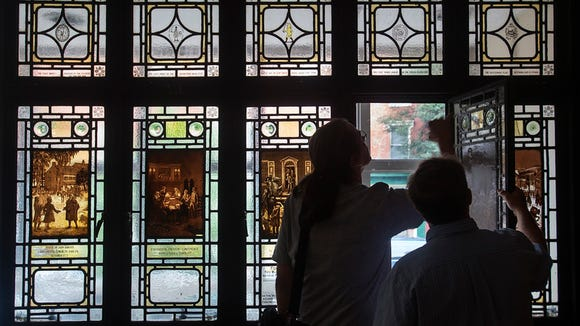 Stained glass windows depicting colonial history in York. Paul Kuehnel - York Daily Record/ Sunday News