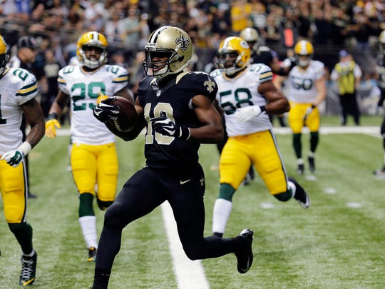 New Orleans Saints wide receiver Brandin Cooks (10) scores a touchdown in the Saints' 44-23 win over the Green Bay Packers on Sunday. Cooks had six catches for 94 yards.