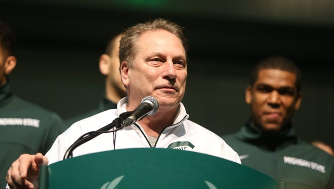 Michigan State coach Tom Izzo addresses fans during a pep rally on Friday, April 3, 2015 at the Convention Center in Indianapolis Indiana.