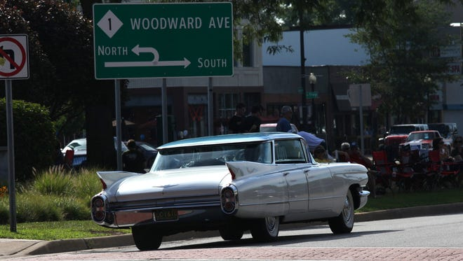 Classic cars cruise woodward in Ferndale during the 2015 Woodward Dream Cruise on Saturday, August 15, 2015.