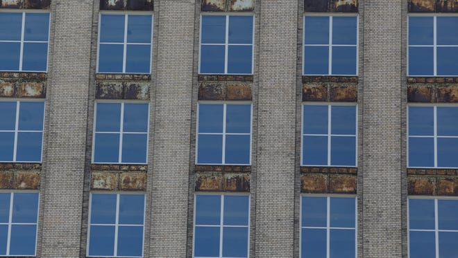 The new windows being installed in the Michigan Central Station are in the opinion of preservationists not historically accurate.