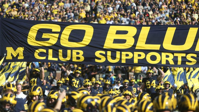 The Michigan Wolverines take the field before a game against the Maryland Terrapins on Nov. 5, 2016 at Michigan Stadium.