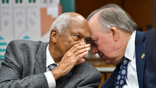 MSU Board of Trustees Vice Chairman Joel Ferguson chats with Interim President John Engler, right, during the first MSU Board of Trustees meeting since the faculty no-confidence vote, Friday, Feb. 16, 2018.