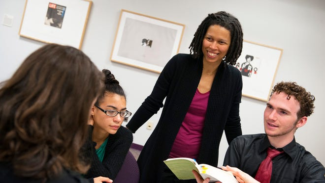 From left: Erin McFadden), Katherine Fernandez, Rutgers Associate Professor Evie Shockley and Nicolas McNamara in the university's Murray Hall Plangere Writing Center in New Brunswick. Shockley is a recent Pulitizer Prize finalist for poetry.