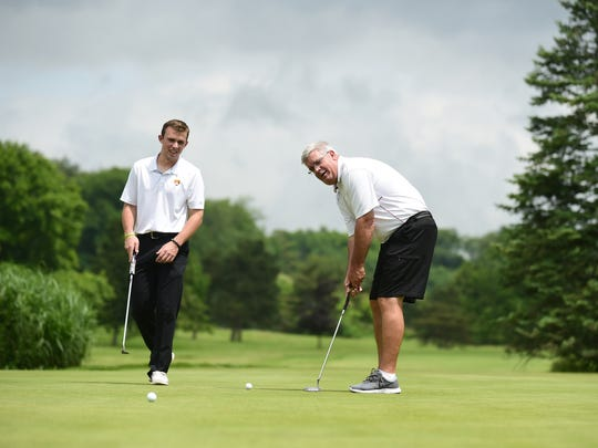 Nick Miller, left, and his father, Dan, on the practice