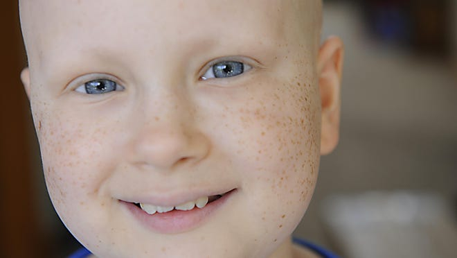 Laura VanDerBos, 12, at home in Grand Ledge June 8, has been living with Neuroblastoma, a form of cancer, since age 4.
