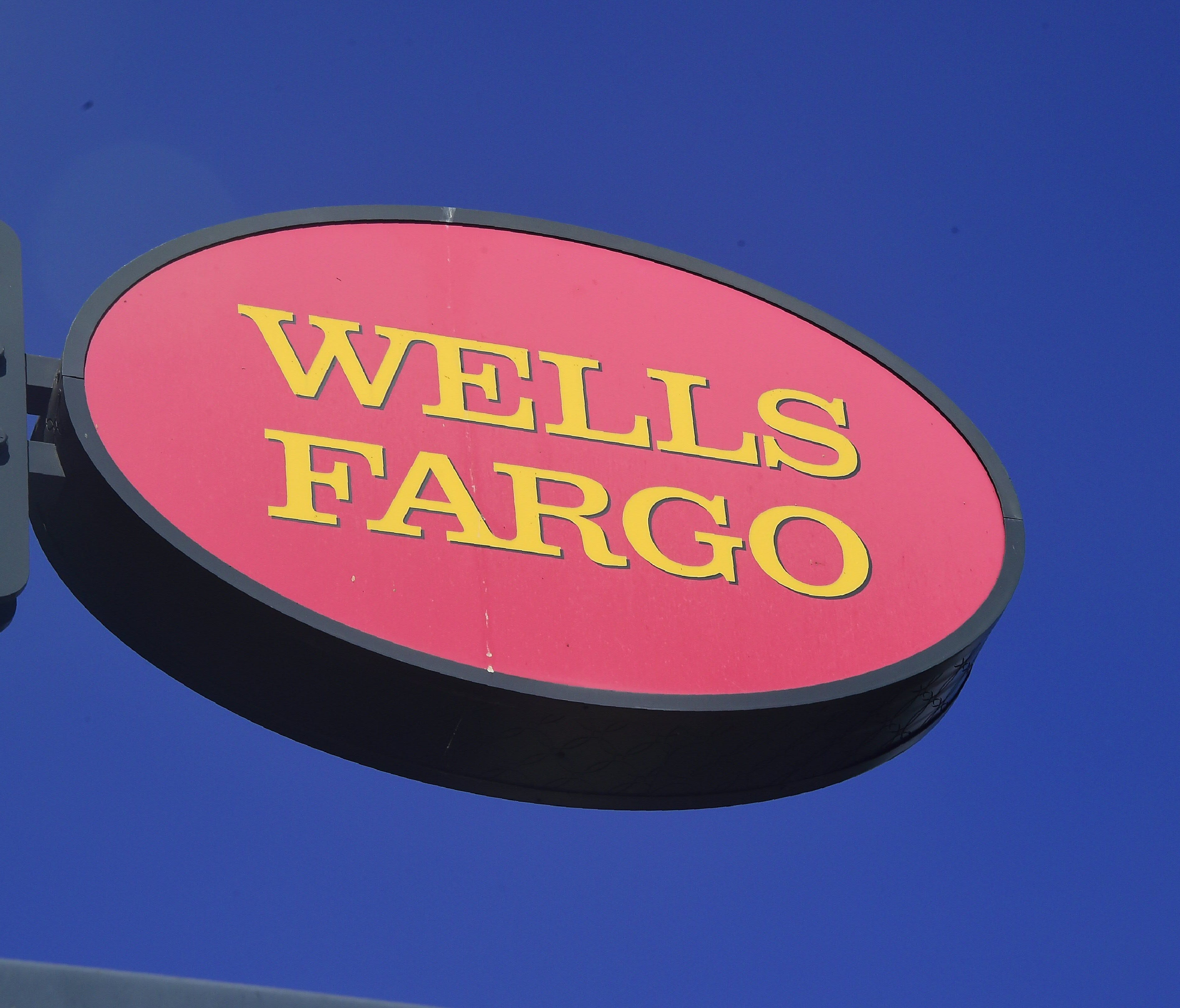 File photo taken in 2016 shows a Wells Fargo sign at one of the bank's  branches in Pasadena, California.