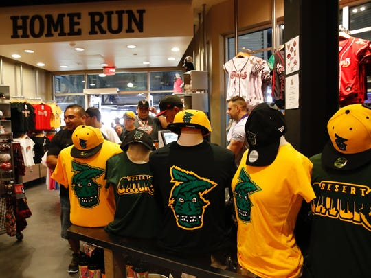 "Individuals line up to purchase the limited edition ""El Paso Desert Gators"" shirts from the El Paso Chihuahuas team shop."