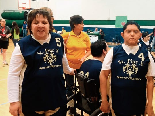 Mayela Valdez and Uriel Hernandez, members of the St. Pius X basketball team, competed in the individual motor skills competition on Saturday at the 2015 Special Olympics Spring Games.