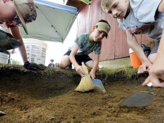 From left, Andrew Riska, 12; Maximus Vener, 12; and Caden McKinney, 13, excavate their square during Archaeology Week at the Horn Farm Center on Thursday in Hellam Township. The weeklong day camp, sponsored by the York County Heritage Trust and York County Parks, is designed to teach participants to take notes, dig and catalog any artifacts they find.