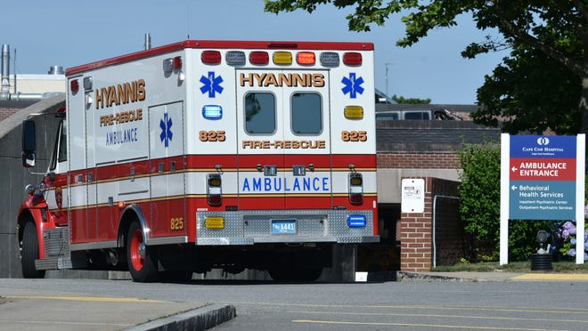 A Hyannis Fire Department ambulance heads into the emergency room tunnel at Cape Cod Hospital. Some departments say they are squeezed by low Medicare reimbursement rates for ambulance fees.