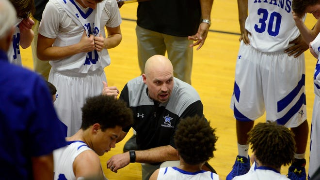 McDowell boys coach Brian Franklin talks to his basketball team during Tuesday's 68-60 home win over Erwin.