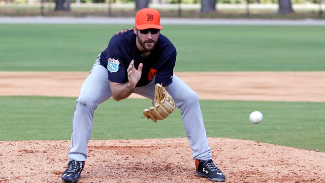 Detroit Tigers starting pitcher Justin Verlander fields a ball during a drill in a spring training Monday, Feb. 22, 2016, in Lakeland, Fla.