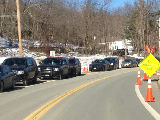 Police cars line the street in Otisville in the Town
